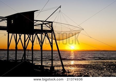 pier with fishing net during sunrise, Gironde Department, Aquitaine, France