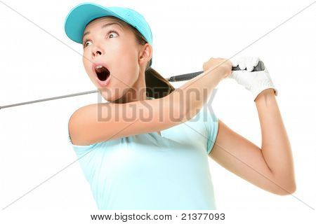 Woman playing golf surprised over golf swing. Female golf player with swinging golf club isolated on white background. Asian Caucasian woman.