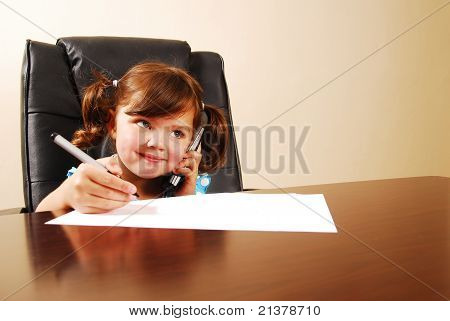 Girl Taking Notes While Talking On Telephone