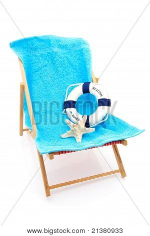 Beach Chair With Blue Towel And Life Buoy