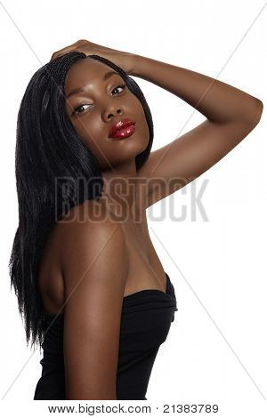 portrait of beautiful South African young woman with long hair loose hair and bright red lips wearing black corset over white background