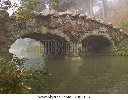 Stone Bridge In Morning Fog