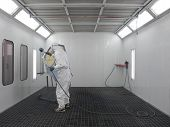 pic of paint spray  - The image of painter works in a spray booth - JPG