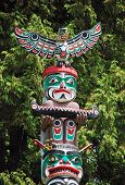 image of indian totem pole  - Colorful totem pole on display in Vancouver - JPG