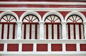Closeup of the red facade of a colonial house in Willemstad, the capital of Curacao, in the Caribbea