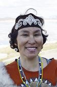stock photo of chukotka  - Portrait of smiling chukchi woman in folk dress - JPG