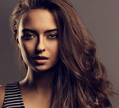 Beautiful Calm Woman With Nude Day Makeup And Effect Eye Brows, Curly Volume Hair Style Looking Myst poster