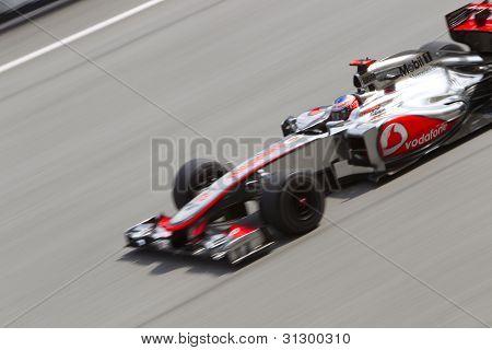 Jenson Button down the main straight