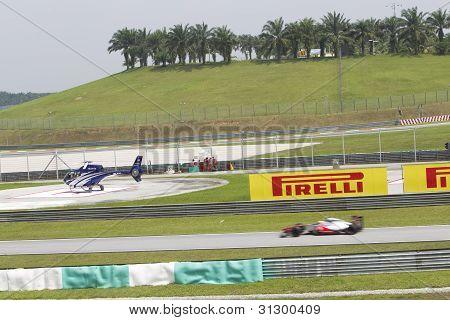 McLaren F1 car enters pit lane