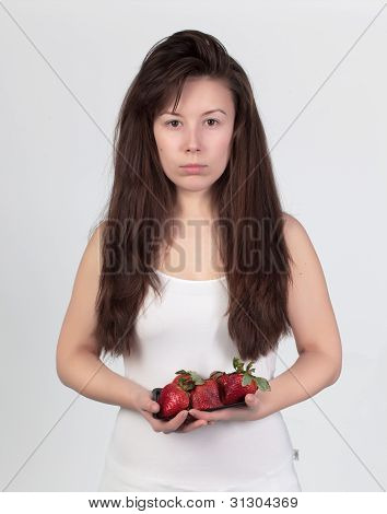 The Young Beautiful Woman With The Fresh Strawberries