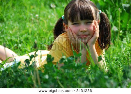 Girl Relaxing In Meadow