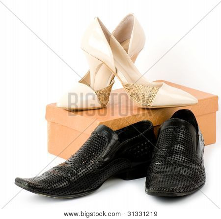 Fashionable male and female shoes isolated on white background.