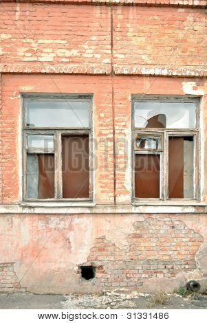 The windows of old dilapidated building