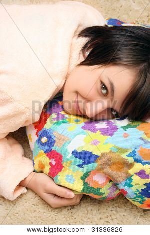 Beautiful Girl Laying On The Colored Pillow