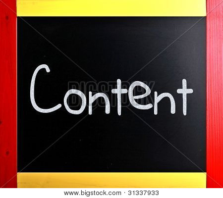 "The Word ""content"" Handwritten With White Chalk On A Blackboard"