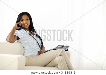 Relaxed Young Lady Speaking On Phone