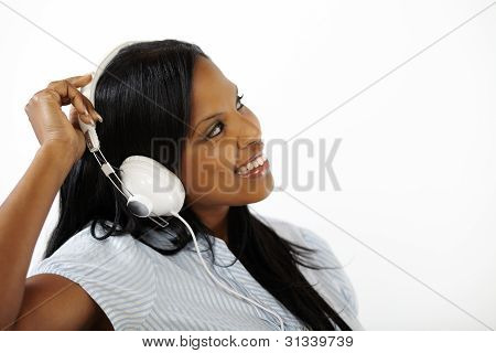 Smiling Young Female Listening To Music