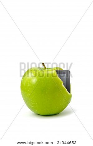 Tablet Pc Coming Out From Green Apple Isolated On White Background