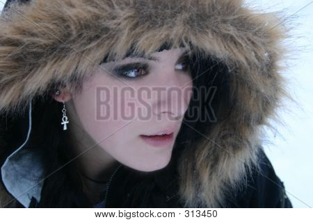 Young Woman In Snow Coat