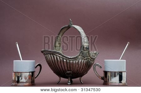 siver vase and cofee cups
