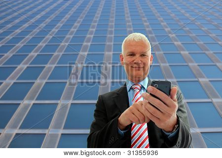 Businessman Writing On His Mobile Phone
