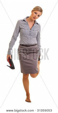 Tired businesswoman feet isolated on white