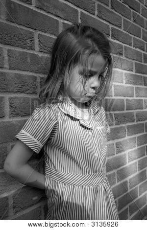 Monochrome Blonde Girl Against Wall