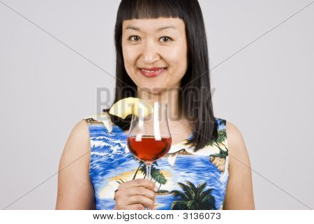 Asian Woman Holding A Tropical Cocktail