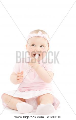 Sweet Little Girl Tasting Candy On Stick