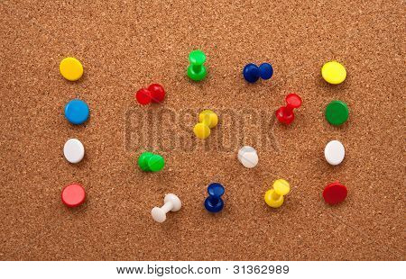 Colorfull Thumbtacks in cork bulletin board