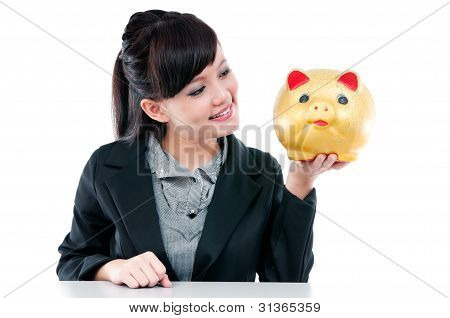 Happy Young Woman Holding Piggy Bank
