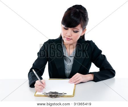 Young Businesswoman Writing Clipboard