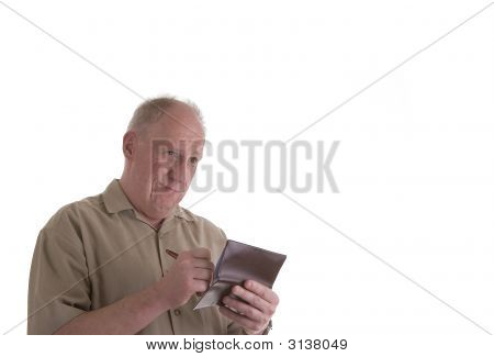 Old Guy Writing Check And Looking Upset