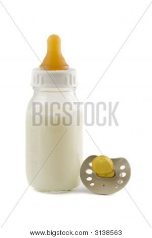 Baby Bottle With Milk And Pacifier Isolated On White