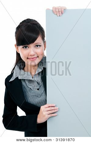 Young Businesswoman Holding Blank Signboard