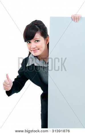 Confident Young Businesswoman Holding Billboard
