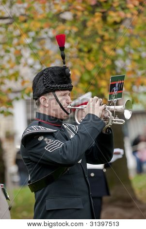 Bugler Sounding The Last Post During The Rememberance Day Service