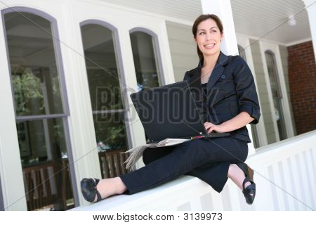 Woman On Laptop Computer At Home