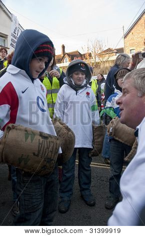 Young Rollers Get Advice From A Committee Member At The Start Of The 2011 Tar Barrels Of Ottery Carn