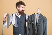 Stylist Advice. Matching Necktie With Outfit. Man Bearded Hipster Hold Neckties And Formal Suit. Guy poster
