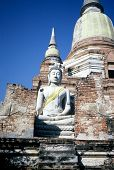 An Image Of The Meditating Buddha Sits Serenely In Front Of The Ruins Of A Chedi At Wat Yai Chai Mon poster