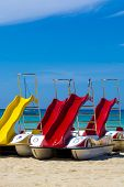 Colorful Pedal Boats With Slides For Rent On Sandy Beach poster