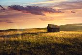 Sunset In Countryside Landscape. Fields And Countryside Landscape. Old Cabin In Nature In Sunset. Na poster