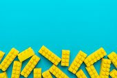 Top View Of Yellow Plastic Blocks. Flat Lay Image Of Yellow Blocks From Child Constructor. Bright Pl poster