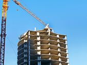 Construction Of A Multi-storey Hotel Complex. Construction Site Background. Crane And Building Under poster
