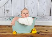 image of washtub  - sweet baby boy playing peek - JPG