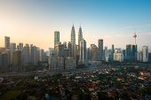 Kuala Lumpur City Skyline And Skyscrapers Building During Sunrise At Business District Downtown In K poster
