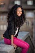 picture of african american woman  - Outdoor of a portrait happy young african american teenage girl - JPG