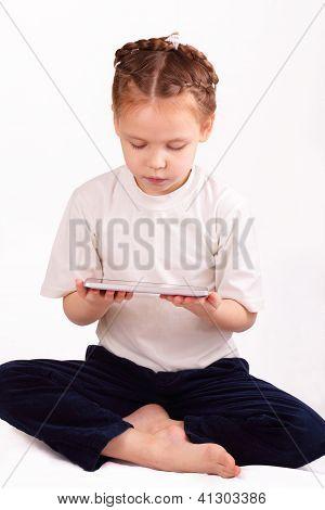Beautiful Little Girl With Modern Ipad