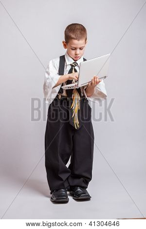 Boy Typing On Laptop